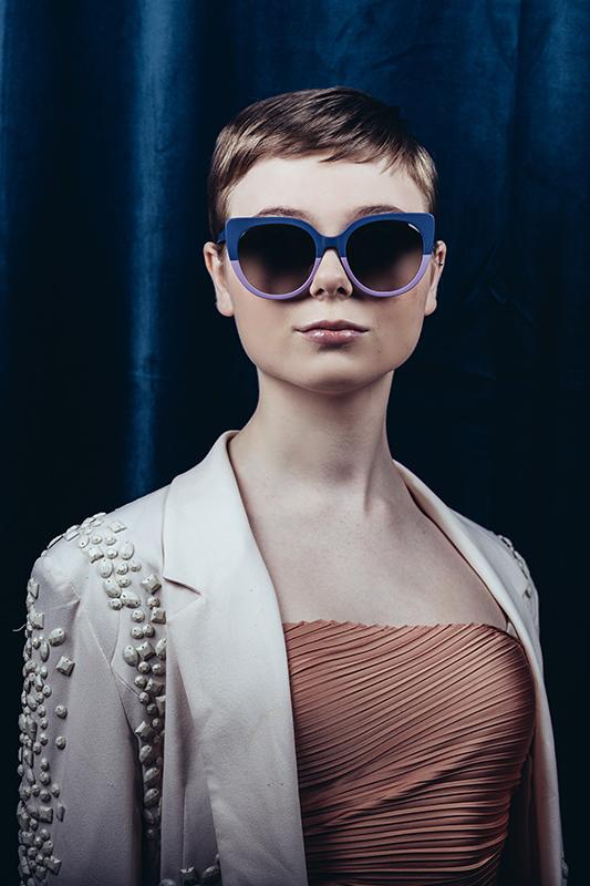 Woman in lavender and purple sunglasses