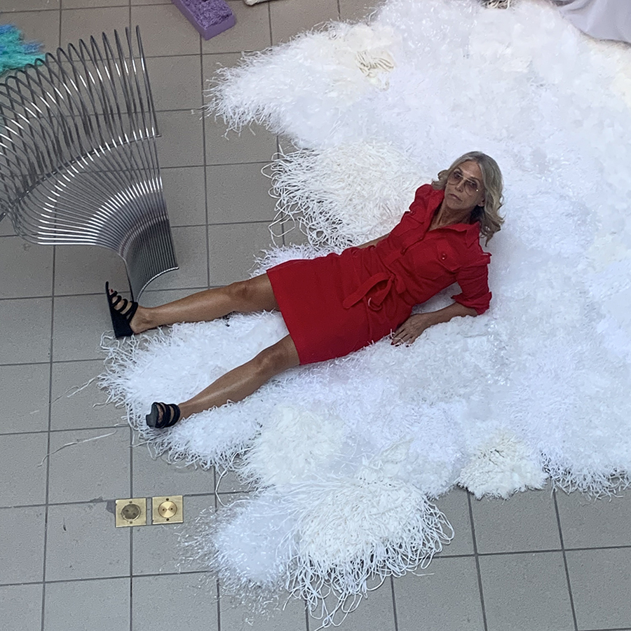Lotta Ahlvar laying down wearing a red dress