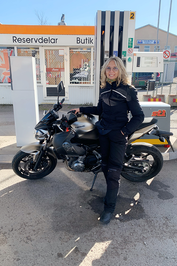 Lotta Ahlvar by her motorcycle