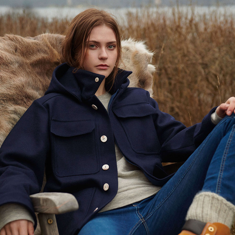 woman wearing Findor wool jacket and wool sweater