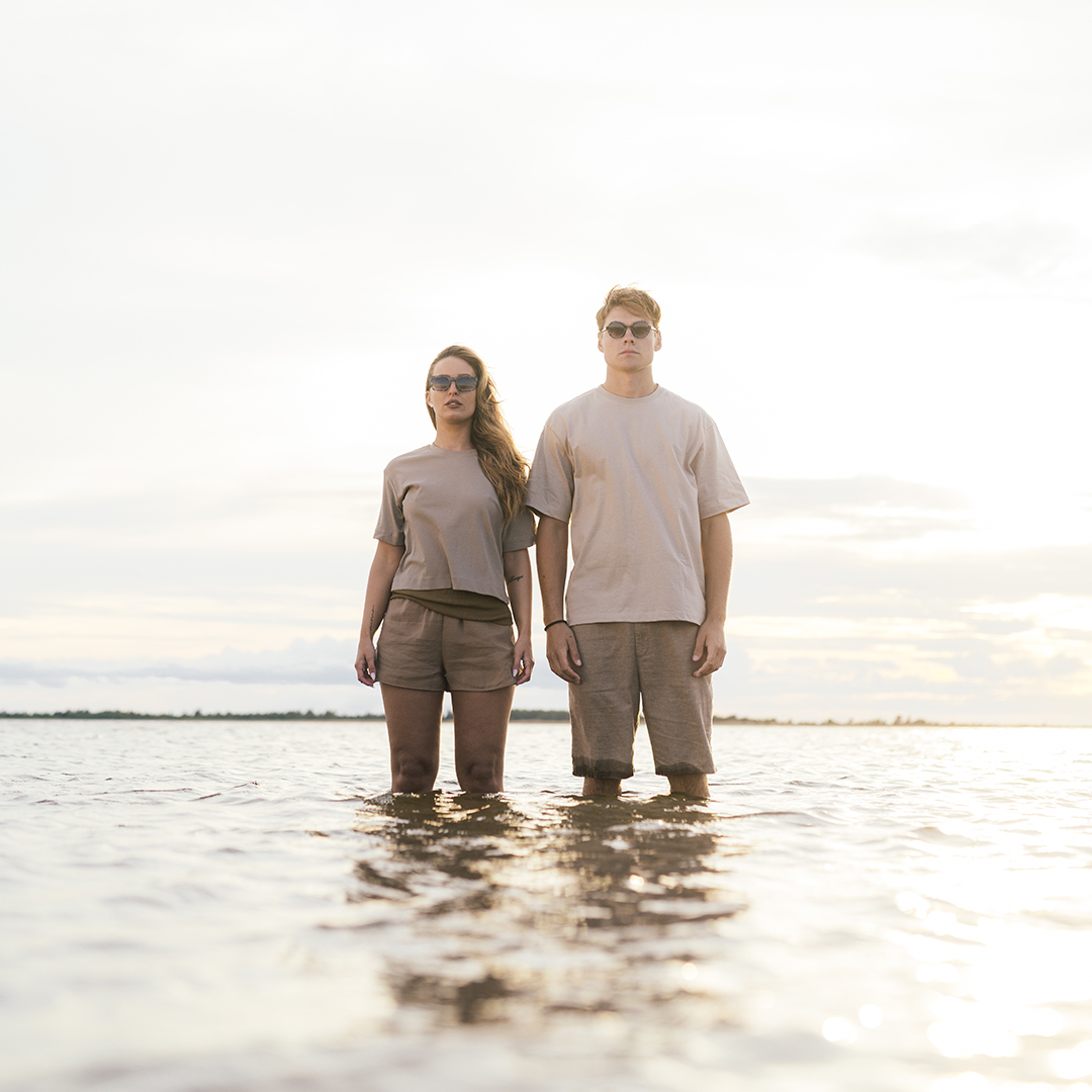 Woman and man standing in the water